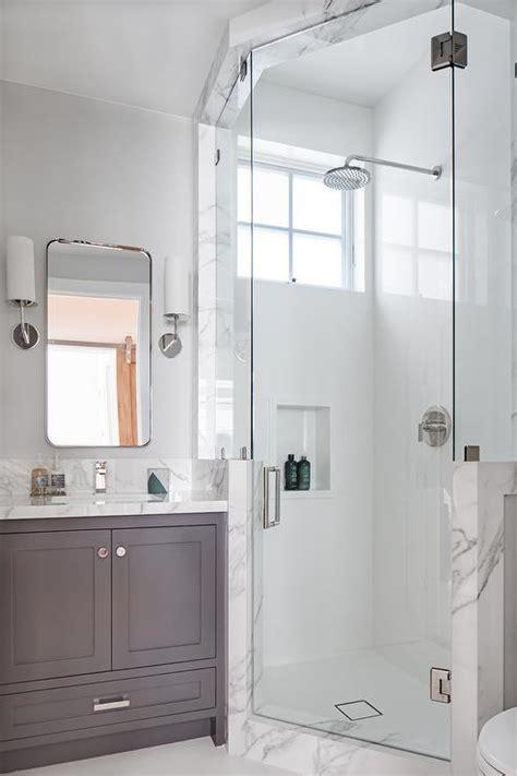 Serene Bathroom Dressed Silver by Corner Shower With Window Seat Transitional Bathroom