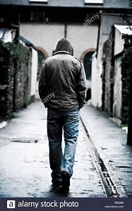 Young man wearing a hooded jacket alone and isolated ...