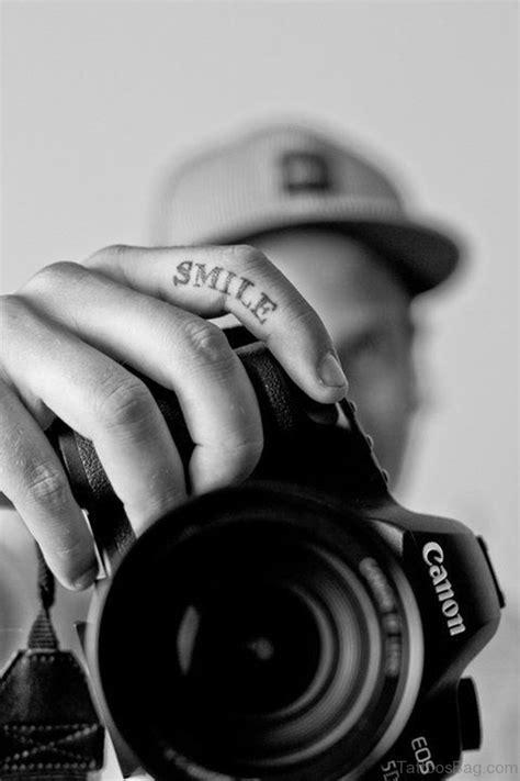 16 Gracious Smile Tattoos On Finger