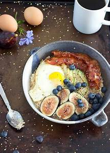 savory oatmeal bowl with eggs avocado and bacon