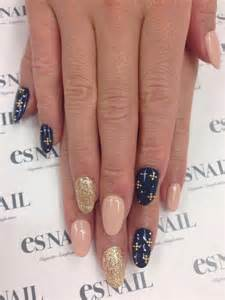 Nail designs art the little gold crosses on navy