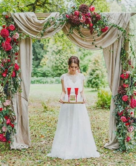 Picture Of A Romantic Red And Burgundy Floral Wedding Arch
