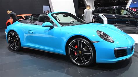 Light Blue Sports Cars by Amsterdam The Netherlands April 16 2015 Light Blue