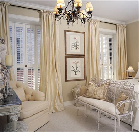 shutters with window drapes living room design
