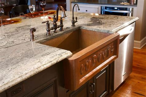 granite countertop with copper sink around the home