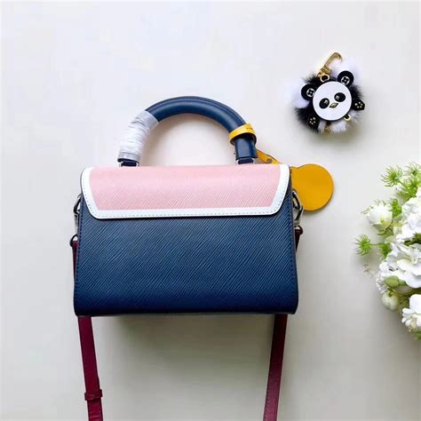 louis vuitton peace symbol lock epi leather twist mm bag  pinkindigo  xlj