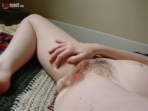 Cute Teen Amateur Shows Off Her Perky Tits And Hairy Pussy
