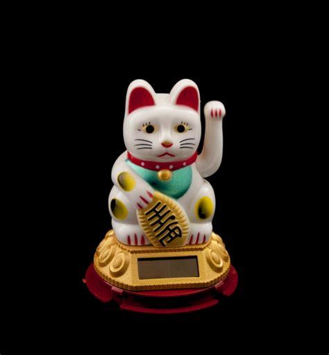chat prosperite japonais maneki neko blanc patte gauche animee solaire 227