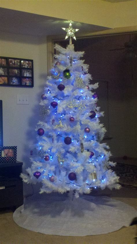 collection of white tree with purple lights
