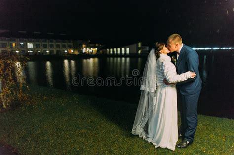 Romantic Wedding Bride And Groom Kissing Near Night Lake