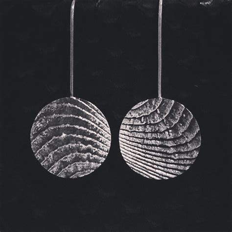 Sterling silver cuttlefish cast earrings