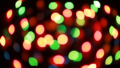 blurred colorful christmas lights on black background with varying fade and twinkle patterns