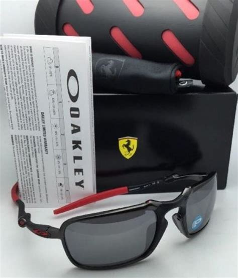 It features a frame which is dark carbon and has a lens which is. Oakley Polarized Scuderia Ferrari Badman Oo6020-07 Carbon & Red Frame Sunglasses - Tradesy