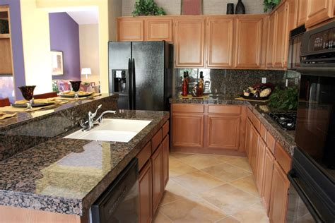 granite countertops with brown cabinets baltic brown granite installed design photos and reviews