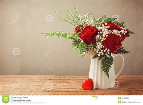 Tabletop Arrangements by Rose Flower Bouquet And Heart Shape Box On Wooden Table