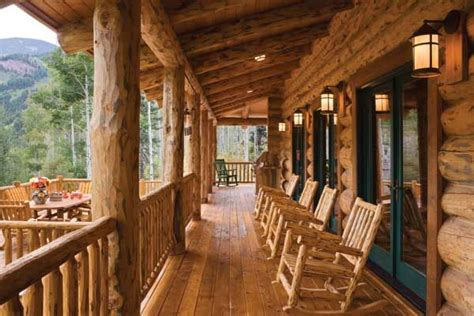 large diameter logs support  front porch lantern style