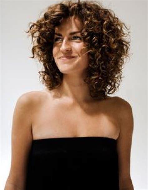 layered haircuts  naturally curly hair top  medium