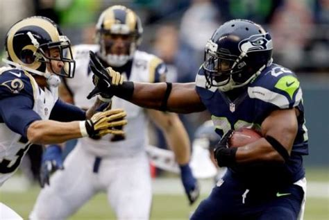 seahawks strike late  beat rams remain undefeated
