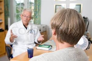 A family doctor giving advice to a patient | Stock Photo ...
