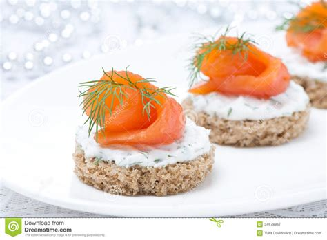 rye bread canapes canape with rye bread cheese salmon and greens