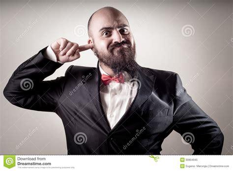Funny Elegant Bearded Man With Finger In The Ear Stock