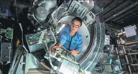 a technician performs an inspection at the ge healthcare