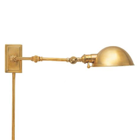 brass swing arm wall lamp intriguinginteriors