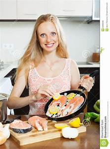 Woman Cooking Salmon With Lemon Stock Photo - Image: 32983590