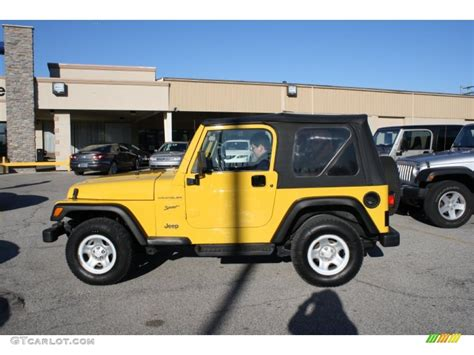 yellow jeep interior 2002 solar yellow jeep wrangler sport 4x4 56874212 photo