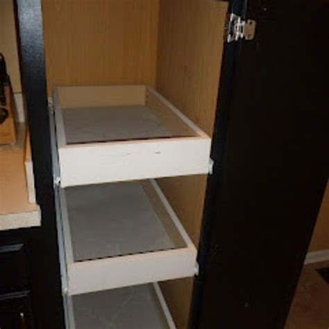 rolling shelves for kitchen cabinets installing rolling shelves in kitchen cabinets diy