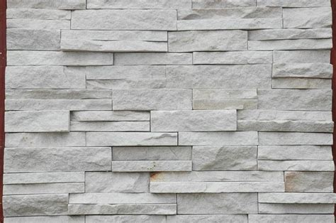 white stacked the stacked stone veneer will be our backsplash and also cover the whole fireplace floors