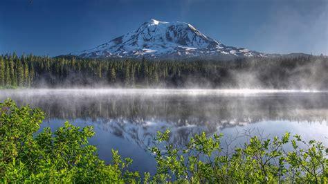 nature landscape mountain mist snowy peak trees