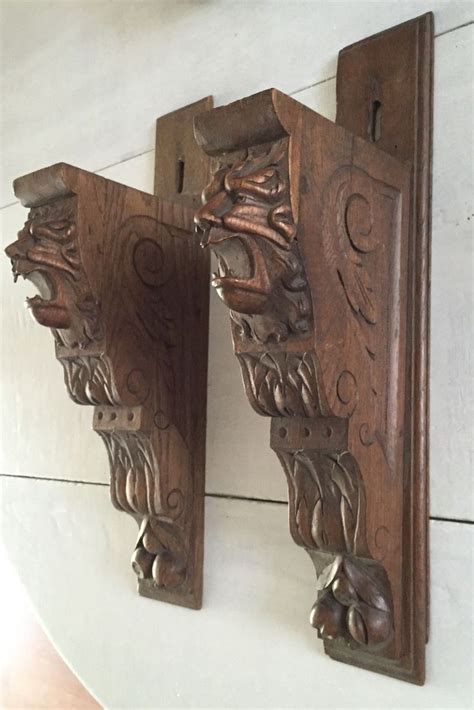 pair oak carved wood wall brackets shelf supports  lion