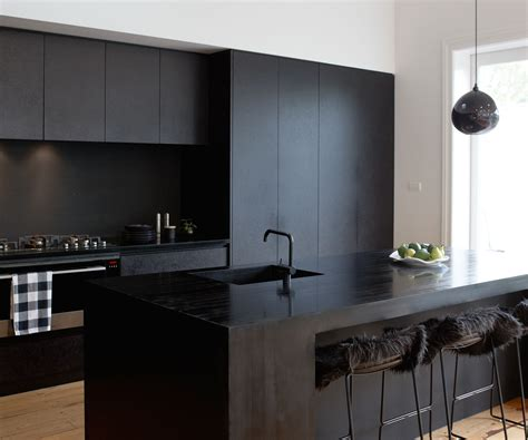 bathroom design magazines a matte black kitchen makes a bold statement in this