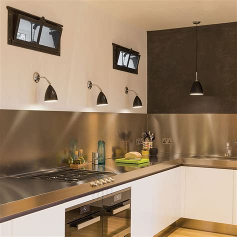astro joel black and polished chrome wall light at uk
