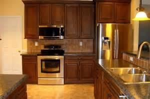 kitchen backsplash cherry cabinets cherry cabinets with black glaze tile backsplash hd laminate tops
