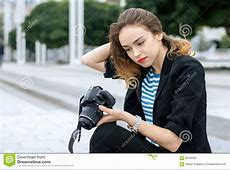 Photographer Taking Picture Of Sitting Model Stock Photo