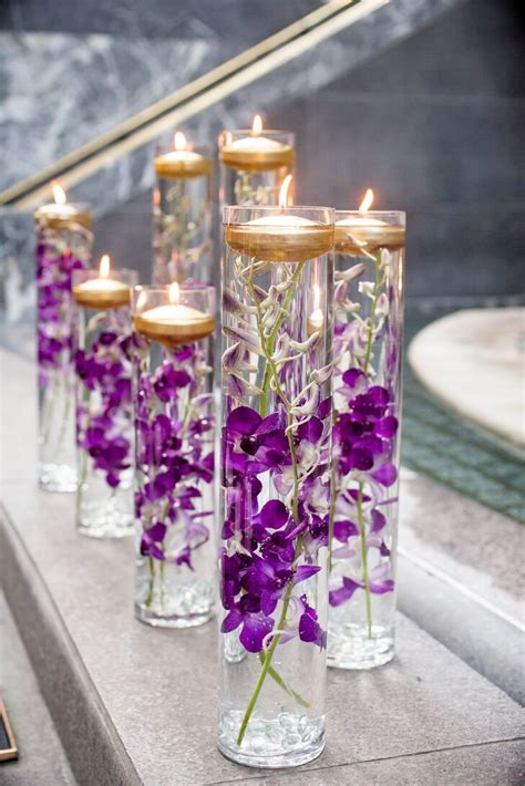 Decorating Ideas Vases by Glass Vases With Purple Orchids And Floating Candles