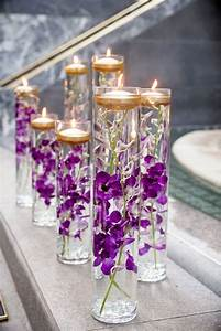 Purple Lights In Chicago Glass Vases With Purple Orchids And Floating Candles