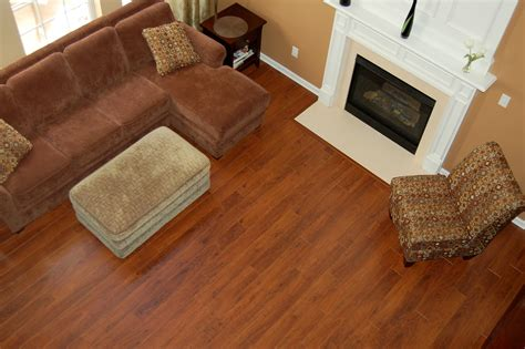 laminate flooring next to fireplace flooring brown sectional sofas with fireplace and how much does it cost to install hardwood