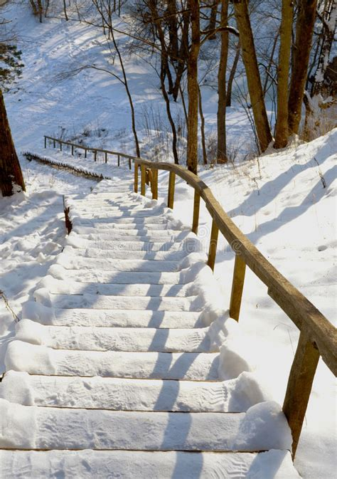 stairs handrail steep mountain covered snow winter stock