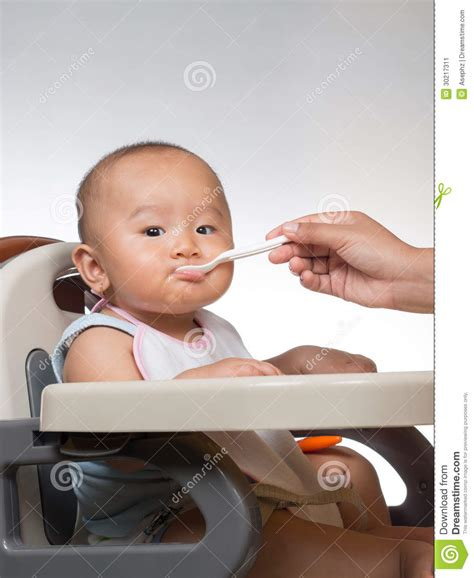 Baby Starting On Solids 4 Stock Image Image 30217311