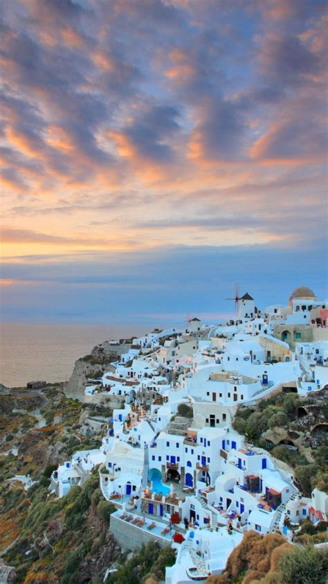 Sunset At Oia Village On Santorini Island Greece