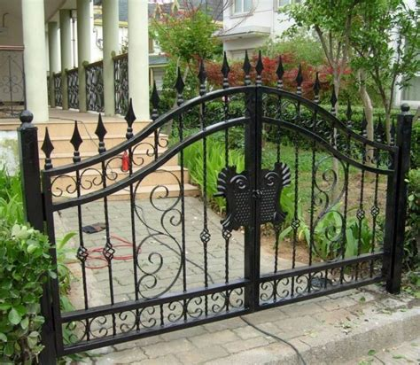 villa wrought iron gates open patio doors residential unit