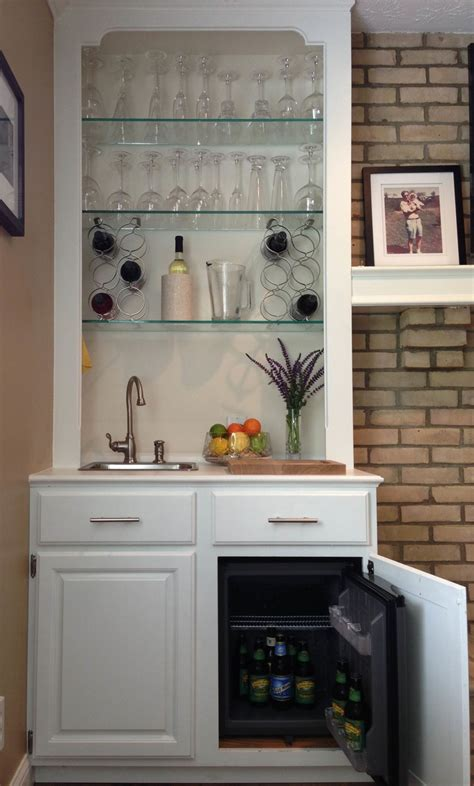 Attractive, durable and very useful home bar with a metal construction. 4 Great Built-in Mini Fridges of the Year - HomesFeed