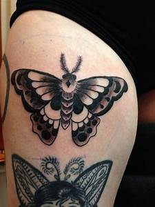 Traditional Black And White Moth Tattoo
