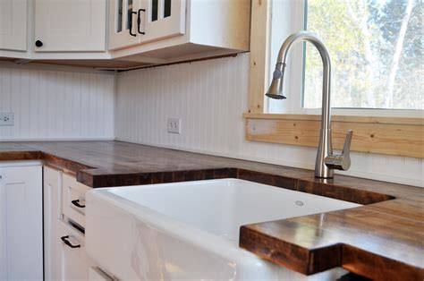ikea butcher block countertops three wooden spoons from a simple kitchen beyond
