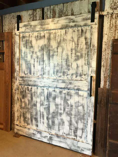 ranch style barn door  distressed white furniture   barn