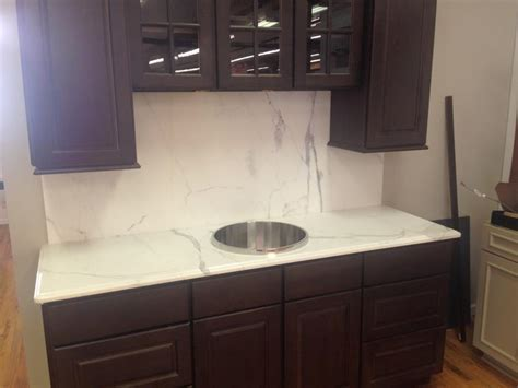 Mountain Empire Stoneworks ? Calacatta Gold marble with a