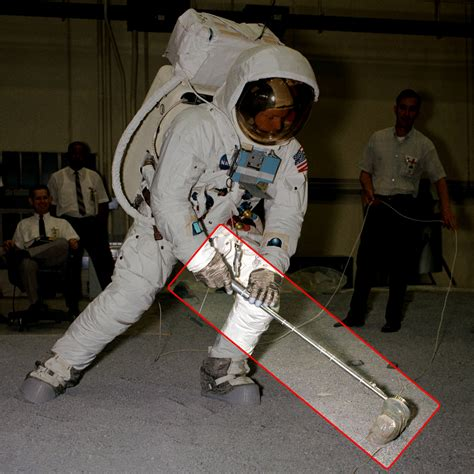 Apollo 11 Commander Armstrong demonstrates how the first ...